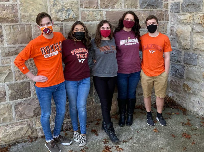 The 2021-22 Transfer Experience Leadership Council stands against a Hokie Stone wall on campus.